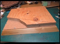 A piece of plywood was screwed on the main base to provide elevation for the road in the diorama.