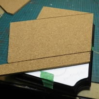 I used cork sheets for the road surface, since the texture of it is quite close to the texture I want. Plus, it is quite easy to damage the cork and make it look like broken concrete or asphalt.