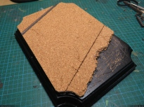 I glued the cork on the wooden base with my hot glue gun. Quick and simple.
